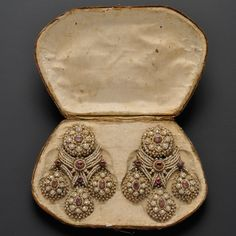 Fine and Rare Pair of Antique Seed Pearl and Ruby Girandole Earpendants, Southern Italy, mid-18th century, with bezel-set rubies and delicately threaded seed pearls, gold mounts, lg. 3 5/8 in., hallmarks, within original fitted box
