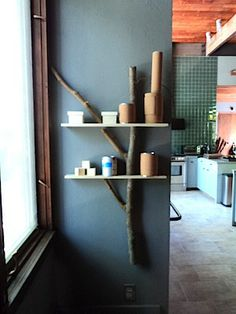 To make the proposed shelves above the microwave more attractive.  See Twig Board for more shelf/branch ideas.