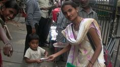 An innocent child joyfully receiving food