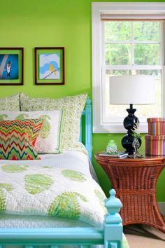 Green and all its hues—including moss, emerald, pine, willow, charteuse, lime, olive, mint and forest—can add serenity, playfulness or elegance to a room.  (I like all the elements of this room!)