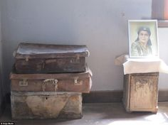 Ready to leave: Suitcases piled up in a house in Santa Laura that were left behind