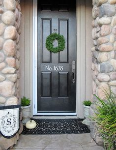 Glidden Onyx Black front door color from Home Depot Black Front Doors, Front Door Colors, Front Door Decor, Tan House, House On The Rock, Rock Siding, Spray Paint Colors, Porch Decorating, Decorating Ideas