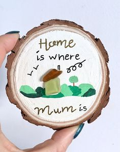 """Here's one of my cute wood slice ornaments for Mother's Day. Stand is included. The art piece measures approx 9cm and is hand painted on a real wood slice with sea glass embellishment. The quote reads """"Home is where Mum is"""" but it can be changed. Perfect for a Mother's Day gift. The"""