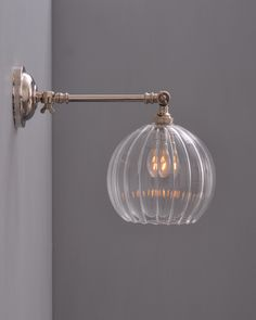 The Hereford ribbed globe adjustable wall light is a simple, ribbed glass globe which is mouth-blown in the UK and available on a wide variety of fittings Pendant lights and Clear glass fittings can be seen below in related products Glass Globe, Handmade Lighting, Adjustable Wall Light, Tv Wall Design, Glass Classic, Light Fittings, Glass Wall Lights, Light, Glass Wall