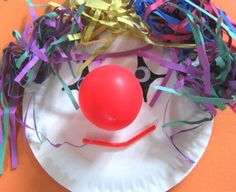 Carnival / Circus Craft: use colorful paper shred for hair and an inflated balloon for the nose!