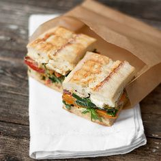 Pressed roasted vegetable sandwich with goat cheese, arugula and balsamic