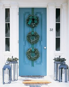 like the look of 3 wreaths on the door!