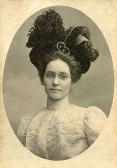 Bespectacled beauty, c. 1900 Victorian antique photograph with period style hair