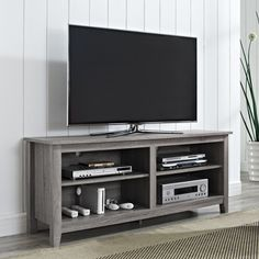 What's old is new again with this urban reclaimed 58 inch TV stand. Crafted from high-grade MDF and durable laminate. Accommodates most flat-panel TVs up to 60 inches. Features adjustable shelving that provides ample space for media accessories. Entertainment System, Entertainment Room, Reclaimed Wood Tv Stand, Weathered Wood, Living Room Sets, Living Room Decor, Condo Living, Living Spaces, 60 Inch Tv Stand