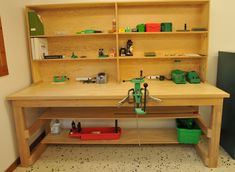 """The reloading bench that I designed and hubby built. (I sanded and clear coated). 8' x 3' x 36"""" tall. Upper shelf unit 10"""" deep, 42"""" tall. Frame, fir 2x4s; bench top, 2 sheets 3/4"""" fir plywood. It's solid! Turret press not bolted down yet. Not 100% sure where I want it on the bench."""
