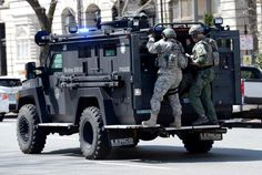 A police SWAT team patrolled the streets in the vicinity of the Boston Marathon as an investigation continues into dual bombings at the site in Boston.