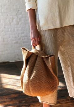 Slouchy bowl bag from Lauren Manoogian. Soft circular construction with side sli. Slouchy bowl bag from Lauren Manoogian. Soft circular construction with side slit handles. Raffia like texture. Crochet Bowl, Hand Crochet, Hand Knit Bag, Sacs Tote Bags, Reusable Tote Bags, Crochet Handles, Paper Bowls, Summer Bags, Luxury Handbags
