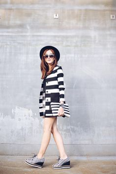 I love stripes so this is my ideal outfit, wearing striped coat, clutch and striped shoes! Black top and skirt and boater hat as the final touch.