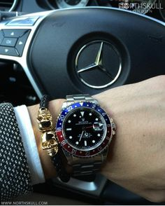 Fan Instagram Pic ! | While behind the wheel of his Mercedes @Dveraza posted a cool photo of his Rolex GMT Master Watch nicely paired with our Premium Black Nappa Leather & Gold Twin Skull Bracelet. Great combo ! | Available now at Northskull.com | For a chance to get featured post a cool photo of your Northskull jewelry with the tag #Northskullfanpic on Instagram