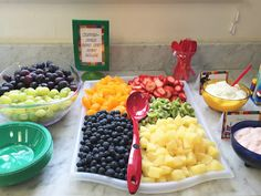 """Master build your own fruit salad"" food idea for our Lego Movie themed birthday party. Click or visit FabEveryday.com for more photos and instructions for many Lego-themed party DIY projects"