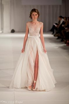 Okay, the upper would have to be less sheer, and the skirt would have to have at least a mini-skirt length satin slip, but this would be GORGEOUS as a wedding dress.