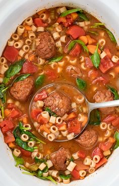 Ladle of meatball soup in slow cooker