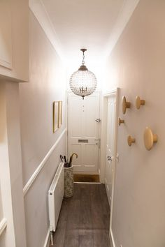 Entrance hallway with suzy hoodless feature wallpaper and for Hallway bathroom ideas