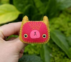 Angelica - wool felt brooch by *Hannakin on deviantART    The stitching makes this super extra excellent.