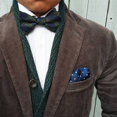 Brown corduroy jacket, white shirt, navy & green plaid tie