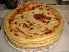 """African Chapati, delicious and filling, can be eaten at any meal alone or with curry, stews, sauce and even made into """"french toast. Chapati Recipe Kenyan, Chapati Recipes, Roti Recipe, Burfi Recipe, Mandazi Recipe, Kenya Food, Indian Food Recipes, Kenyan Recipes, African Recipes"""
