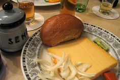 """Halve Hahn a Rhineland specialty.  It is a rye bun with cheese and butter. The bun is called """"Roeggelchen"""", the cheese is medium ripe Gouda, and it is served with mustard, pickles or onions."""