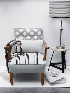 i love this chair but i would have painted the brown wood to black! so cute!