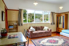 Cottage | Russell-Orongo Bay Holiday Park .Living area of our self contained cottage which can comfortably sleep 6. 1x double bed a set of bunks and a sofa bed.