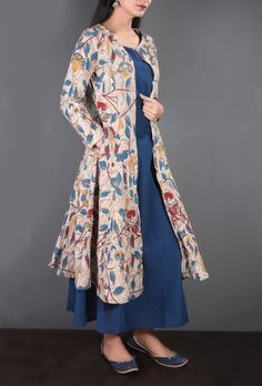Description: A beautiful Kalamkari set designed with a touch of tradition. The set has a flowy Kalamkari cape in beige flaunting eye-catching Kalamkari pattern of colorful birds, creepers, flowers in tones of blue, red and yellow. This pocketed cape is paired with a blue floor length Anarkali. Material: The set is crafted from pure cotton material and features detailed Kalamkari print. Kalamkari is a form of craft which involves free hand drawing and block printing on textiles. Kalam means…