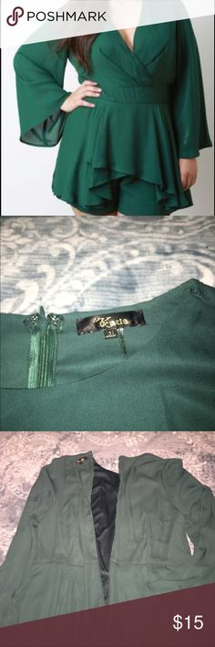 PLUS SIZE ROMPER Dressy dark green romper. Romper has flared sleeves & is very elegant. Zipper in back. Paired great with a chunky necklace & some wedges. Only worn once. Bought online. 100% Polyester. NOT torrid this brand is Katia, used torrid for exposure. torrid Dresses Long Sleeve