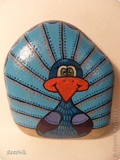 25 Variants Painted Stones and Rock Art | PicturesCrafts.com...cute peacock!!