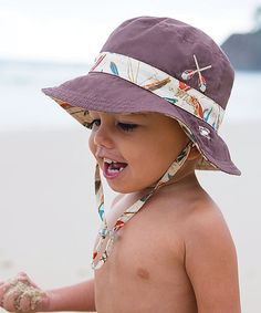 e455e012a7b83 Loving this Tan  amp  Chocolate Outrigger Reversible Bucket Hat on  zulily!   zulilyfinds
