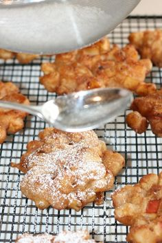 Tap strainer to dust fritters with powdered sugar.