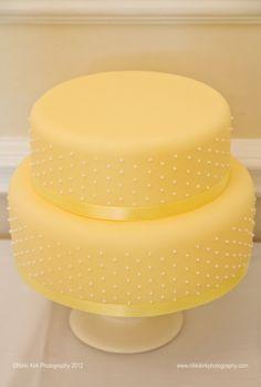 lemon/ yellow tiered cake.