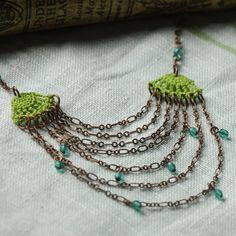 Small green crochet motifs with layers of copper chain and aqua Czech glass.