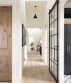 The most gorgeous hallway inspo with white oak floors and sliding French doors v… – Decor Home Sliding French Doors, Double Doors, Hill Interiors, Interior Barn Doors, Interior French Doors, Black Trim Interior, White Walls, White Hallway, Modern Hallway