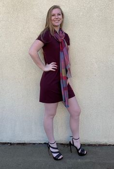 This color is called Merlot - how gorgeous in any season! Short sleeves make it versatile for a jacket or with a scarf, as shown here. Made in the USA, this dress is designed and manufactured by Jana Carrick Designs. Get yours at Zing Boutique, Port Washington, WI.