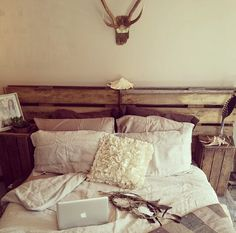 Rustic bedroom decor... would need to fancy this up a bit but I like the wood theme with white.