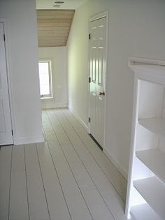 DIY wide planked painted wood floors for $0.45/square foot. (Using plywood! I love this look.)