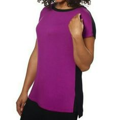 HP 12/5 SHORT SLEEVE DOLMAN TOP PURPLE /BLACK PRICE IS FIRM   Wear it with a black top extender over black leggings. Crew neck with short sleeves. Purple front, black back. Ribbed neck trim. Slight high-low hem. Side slits. Soft, lightweight material. Made in USA  Content (percents can vary slightly among colors):  Self: 95% Rayon | 5% SpandexContrast: 62% Polyester | 34% Rayon | 4% Spandex Ellen Tracy Tops