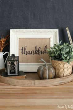 Creating perfectly scripted letters on burlap is easier than you think. Frame this DIY Thankful Sign creation and then leave it out on display.
