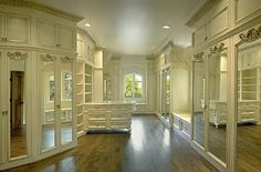 I love how the doors close and keep the contents of the closet covered.  A bit ornate for me, but gorgeous