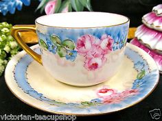 STUNNING TEA CUP AND SAUCER  GERMANY PAINTED ROSES ARTIST SIGNED TEACUP PATTERN
