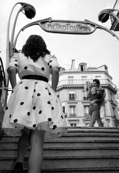 Photographer Gray Malin photographed one girl in one dress – a vintage polka dot Oscar de la Renta – in cities around the world. Here she is climbing the stairs of the Metro in Paris. -Matchbook Magazine