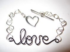 a Lil' Infinite Love Bracelet, www.jazziesandlil..., Price: $15.00, Silver Plated Infinity Symbols with Black Toned Copper Wired Love with Silver Metal Toned Heart Toggle Clasp