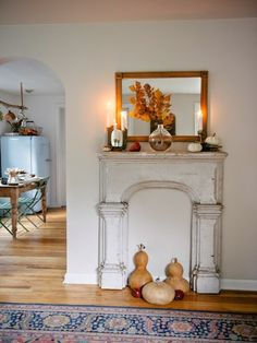 This mantel offers ample space to display seasonal décor like leaves and gourds.