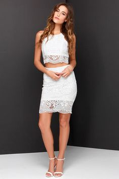 """Get into double the trouble, and have twice the fun with the Double Time Ivory Lace Two-Piece Dress! Stunning crocheted floral lace covers a sleeveless crop top with rounded neckline, and figure-enhancing princess seams. The matching midi-length pencil skirt completes the look with a body-skimming fit, and band of sheer lace at bottom. Top and skirt have exposed gunmetal back zippers. Fully lined in stretch knit. Small top measures 17"""" long. Small bottom measures 21.5"""" long. 100% Polyester. Hand Wash Cold. Imported."""