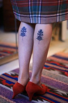 Two flower tattoos on the calves/legs | No Artist Information