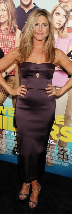 Who made  Jennifer Aniston's purple strapless cut out dress and heels that she wore in New York on August 1, 2013?