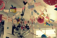 """What a  great idea to use a deck of cards for garland! This is an """"Alice in Wonderland """" Party, how appropriate."""